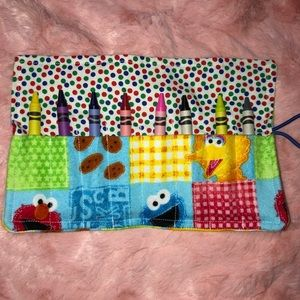Sesame Street crayon roll up holds 8